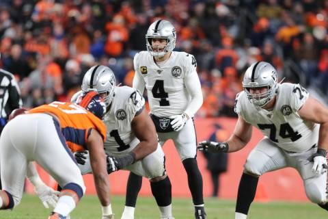 Oakland Raiders quarterback Derek Carr (4) sets up behind his offensive linemen Rodney Hudson ( ...