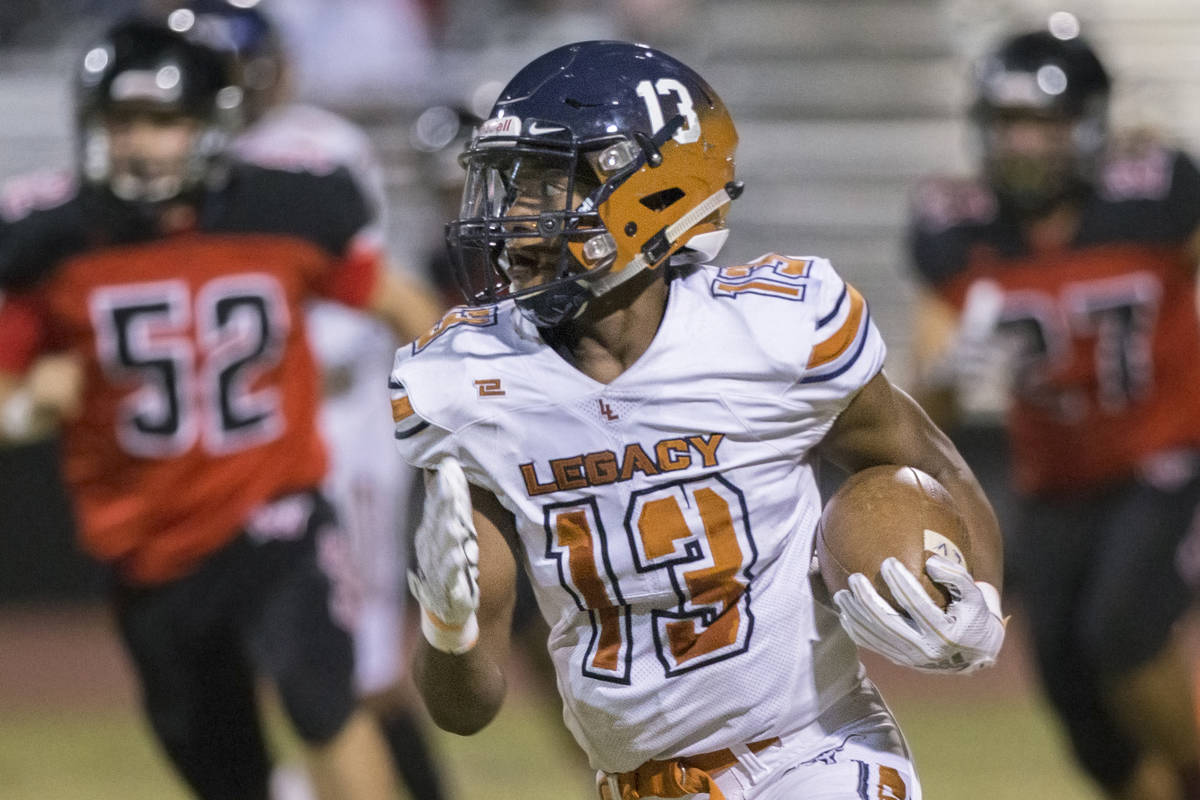 In this Sept. 28, 2018, file photo, Legacy wide receiver Aaron Holloway (13) breaks into the op ...