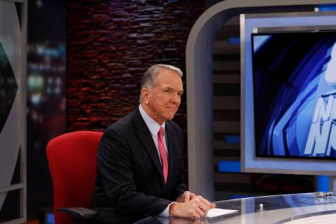Dave Courvoisier is photographed at the KLAS-TV Channel 8 anchor desk, which he inhabited from ...