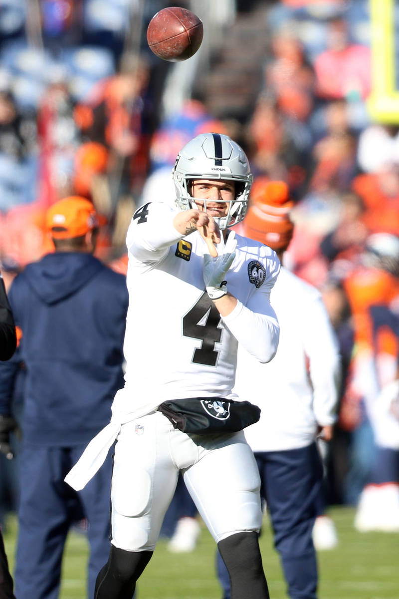 Oakland Raiders quarterback Derek Carr (4) throws the football during warm up drills before an ...