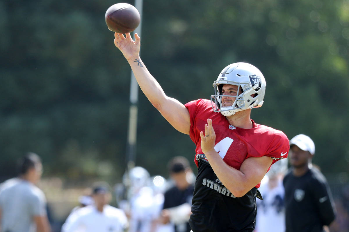 Oakland Raiders quarterback Derek Carr (4) throws the football during the NFL team's joint trai ...