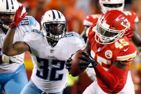Kansas City Chiefs linebacker Ukeme Eligwe (45) intercepts a ball thrown by Tennessee Titans qu ...