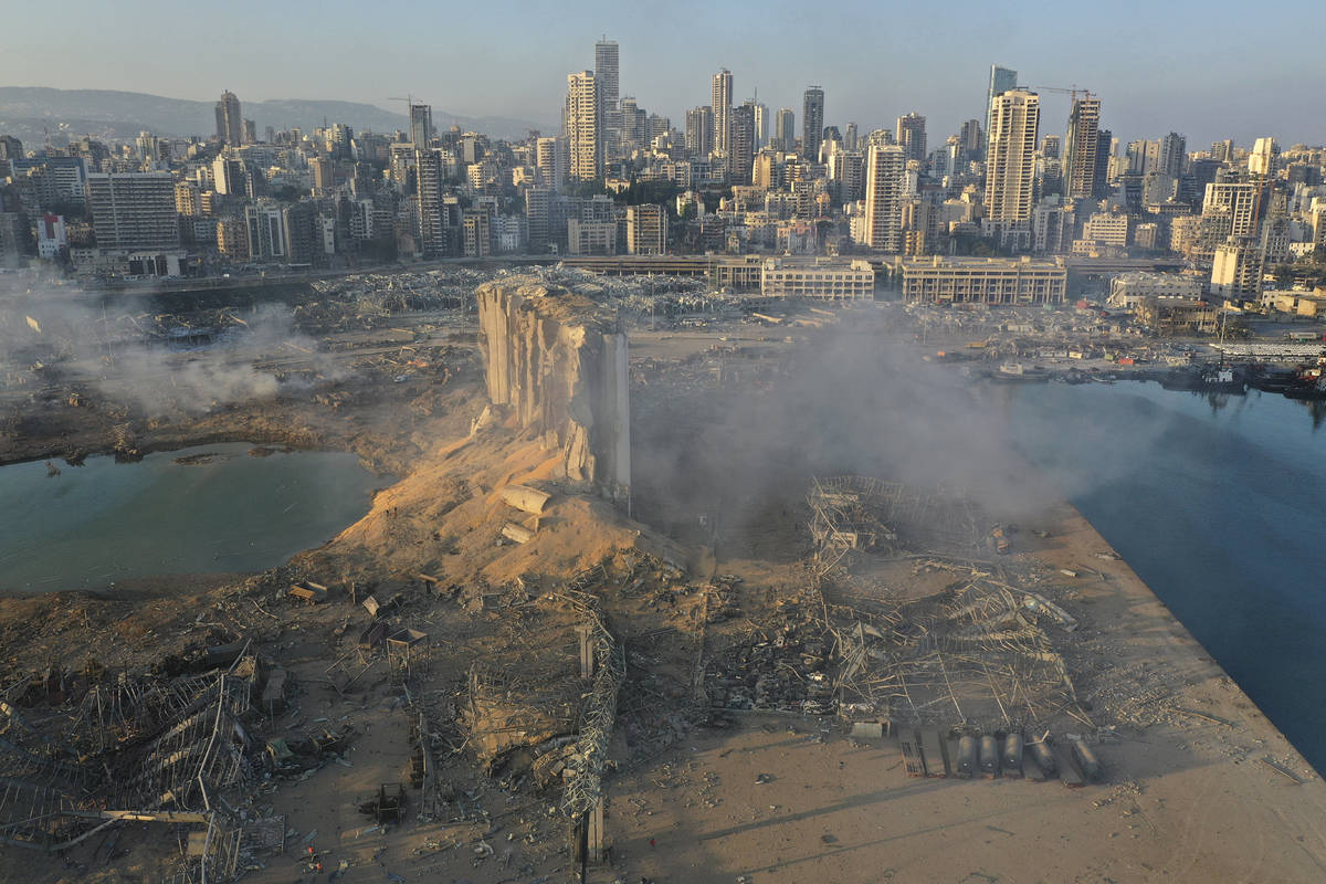 A drone picture shows the scene of an explosion at the seaport of Beirut, Lebanon, Wednesday, A ...