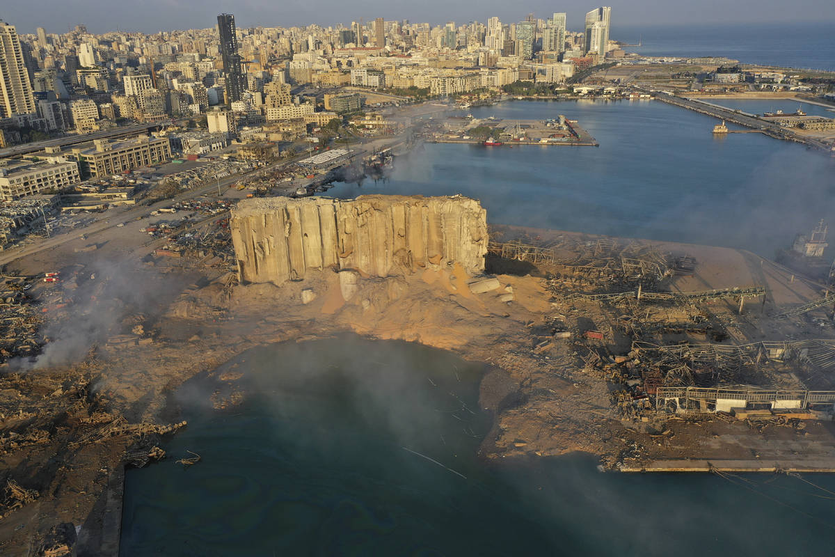 A drone picture shows the scene of an explosion that hit the seaport of Beirut, Lebanon, Wednes ...