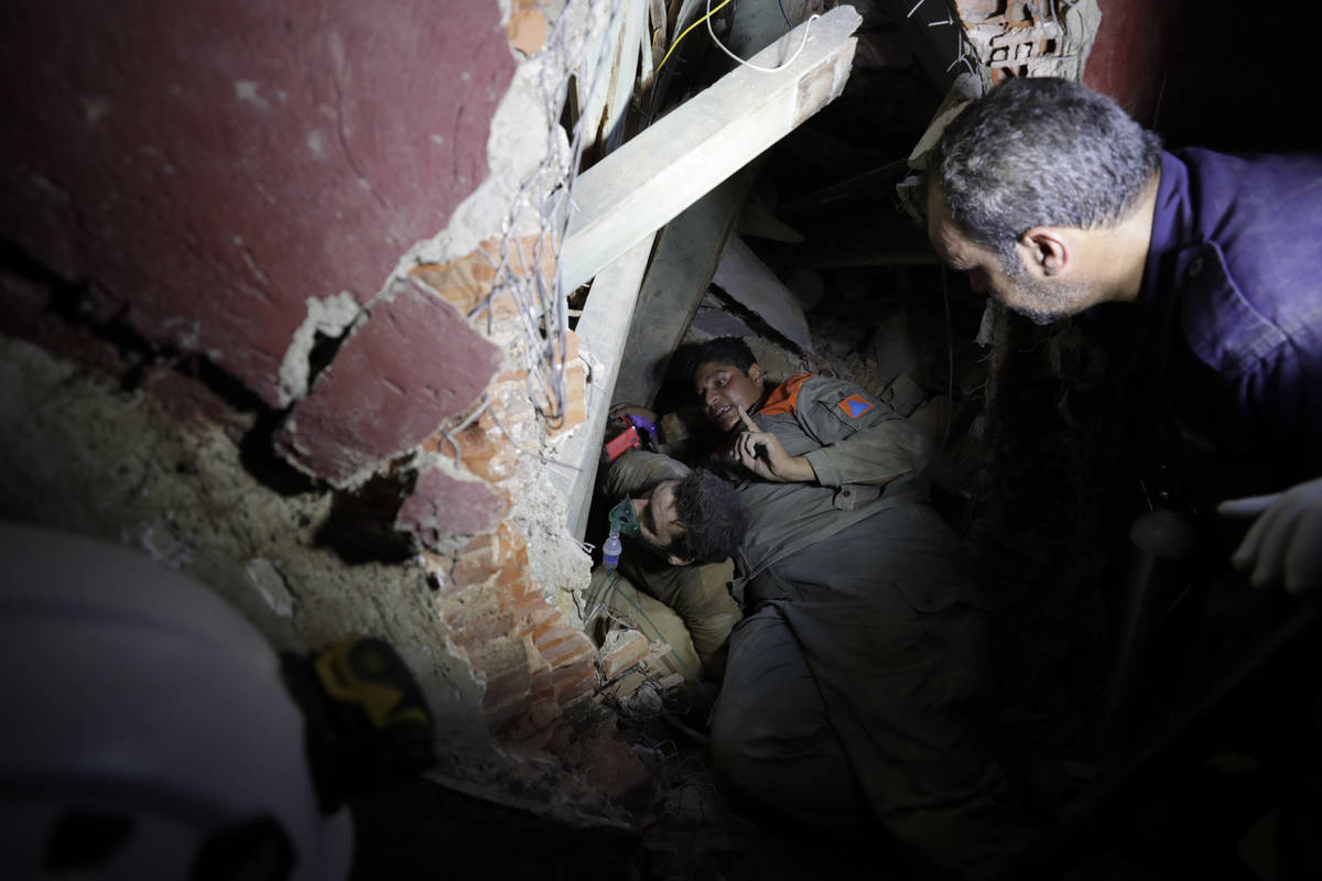 Lebanese soldiers search for survivors after a massive explosion in Beirut, Lebanon, Wednesday, ...