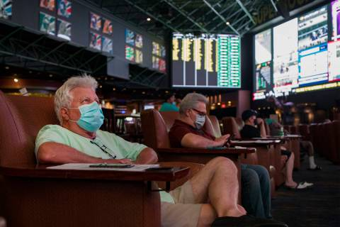 Trip Barclift, of Las Vegas, watches the screens at the Westgate sportsbook in Las Vegas, Thurs ...
