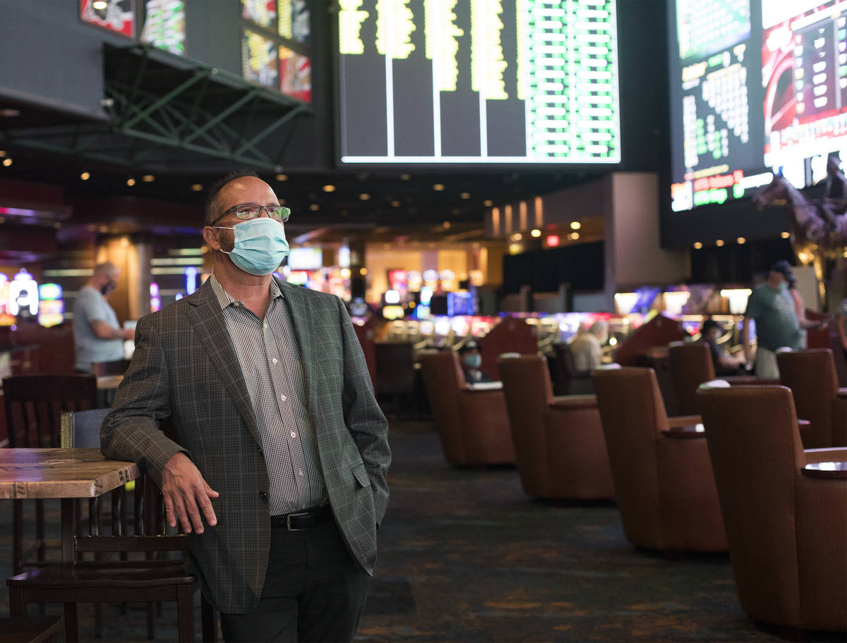 Jay Korneygay, director of the Westgate sportsbook, spends time among guests at the Westgate sp ...