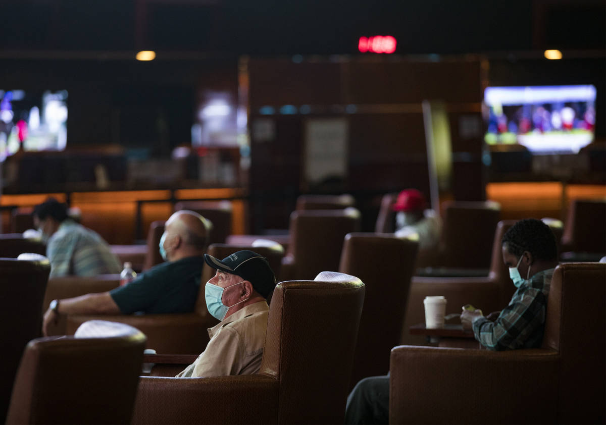 Guests watch the screens at the Westgate sportsbook in Las Vegas, Thursday, Aug. 6, 2020. (Rach ...