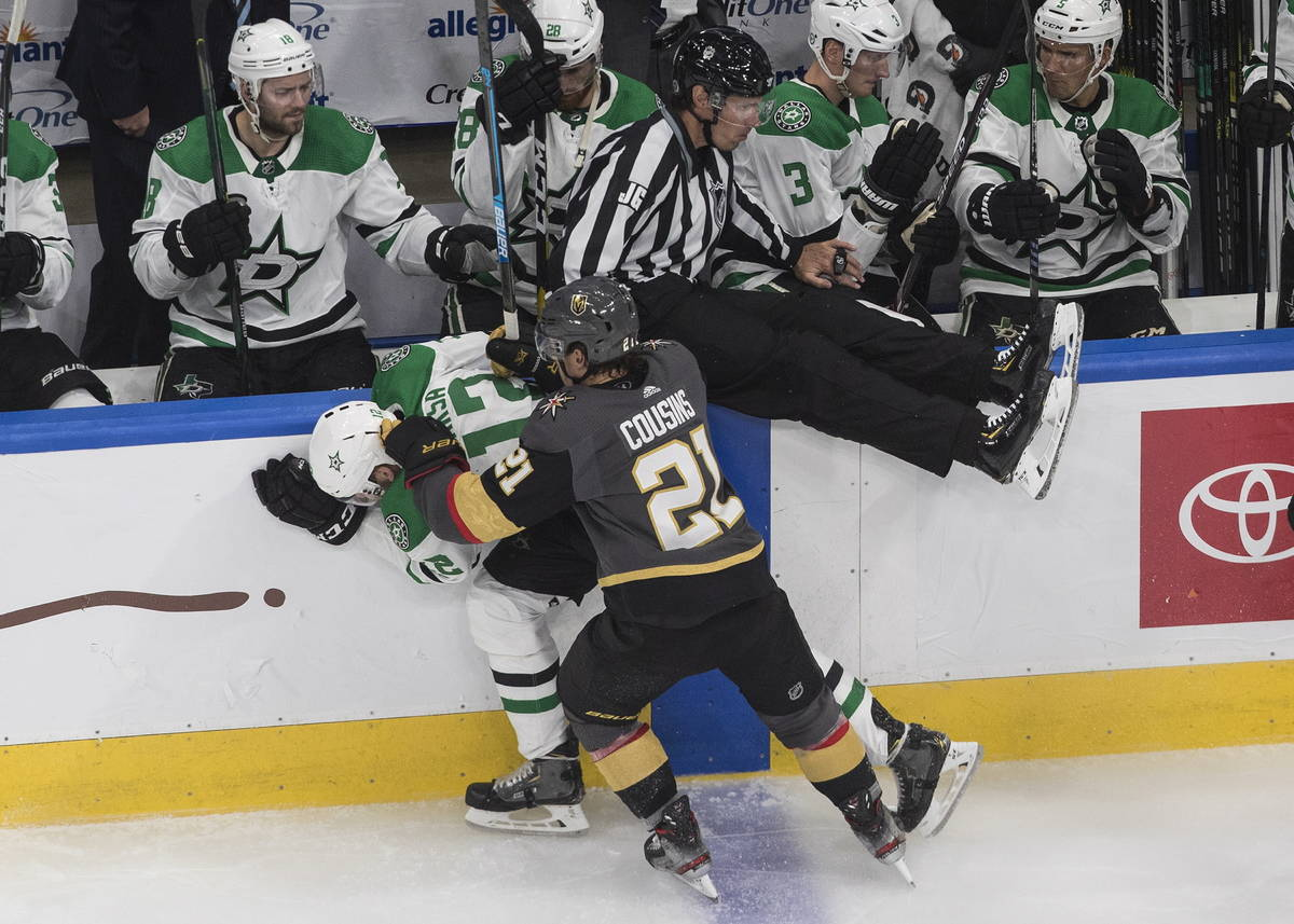 Dallas Stars' Radek Faksa (12) is checked by Vegas Golden Knights' Nick Cousins (21) during the ...