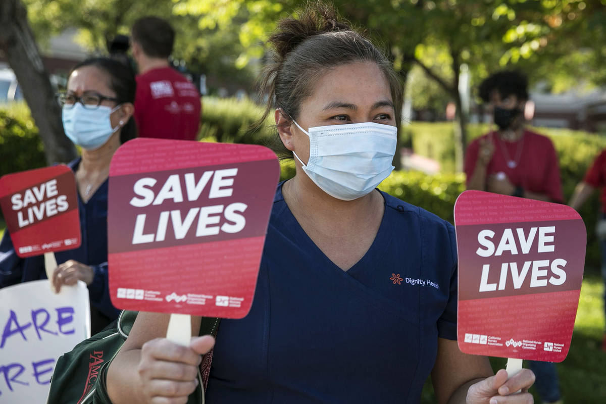 Registered Nurse Marcela Delacuadia pickets outside of St. Rose Siena Hospital calling for more ...
