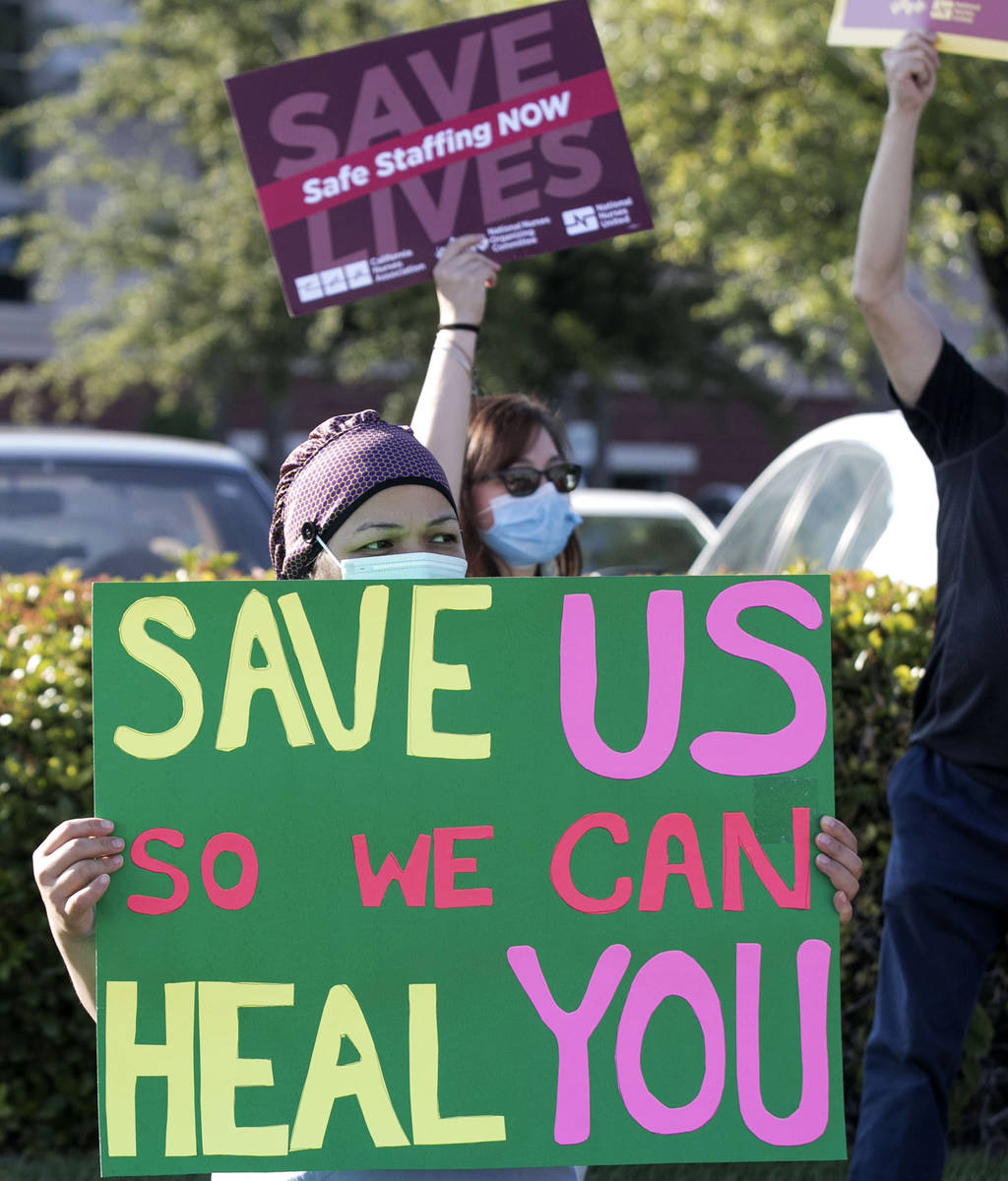 Aleli Posadas, a nurse at St. Rose Siena hospital, pickets outside the hospital calling for mor ...