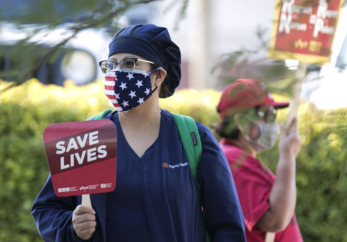 Registered Nurse Kady, who declined to give her last name, pickets outside St. Rose Siena Hospi ...
