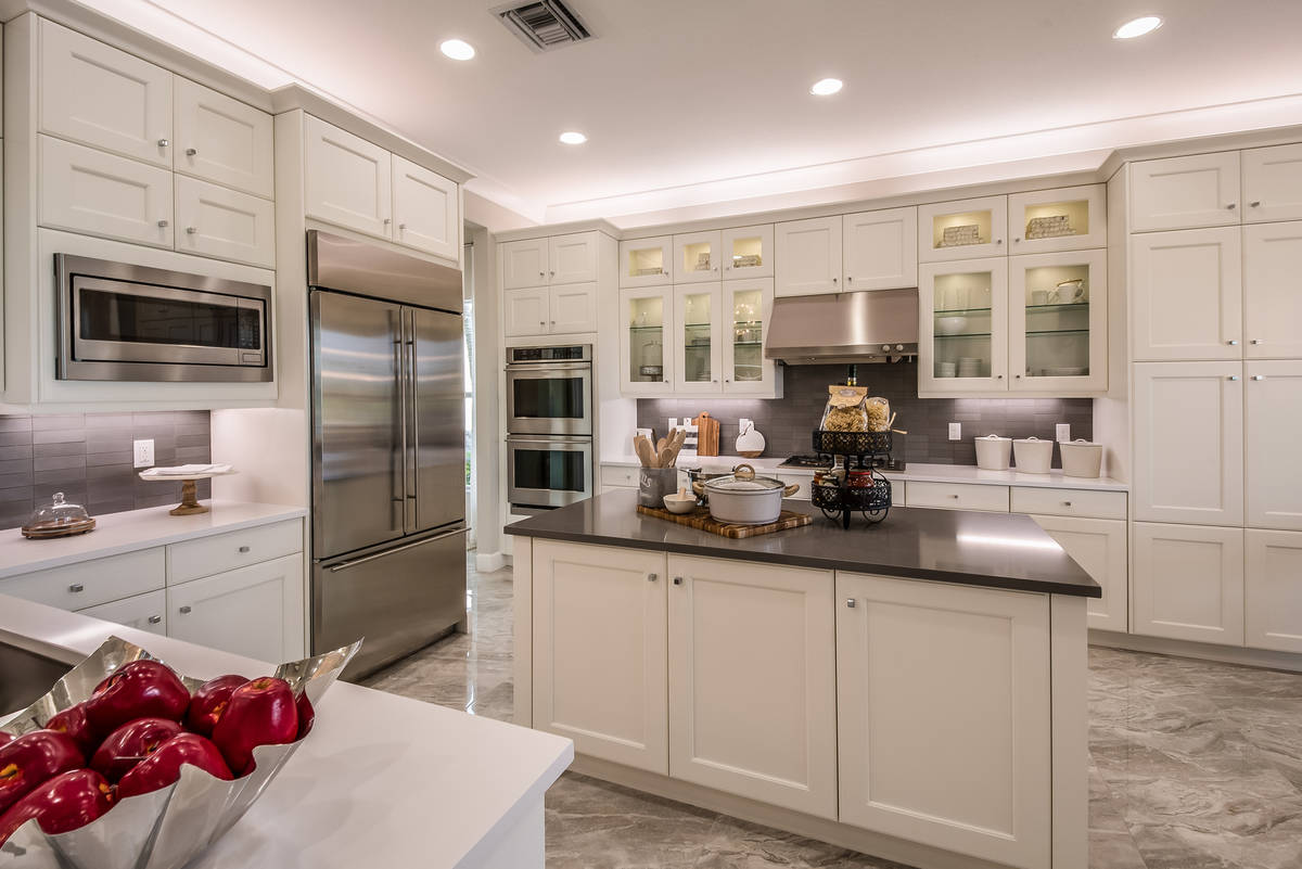 To build a kitchen island, you can buy a pair of base cabinets and screw them together to get t ...