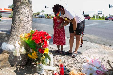 Tiffany Joseph and her daughter Jordan, 6, visit a makeshift roadside memorial on Wednesday, Au ...