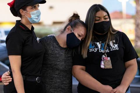 Iliana Dacosta, left, Karen Rene and Fernanda Barraza comfort each other during a vigil for Nel ...