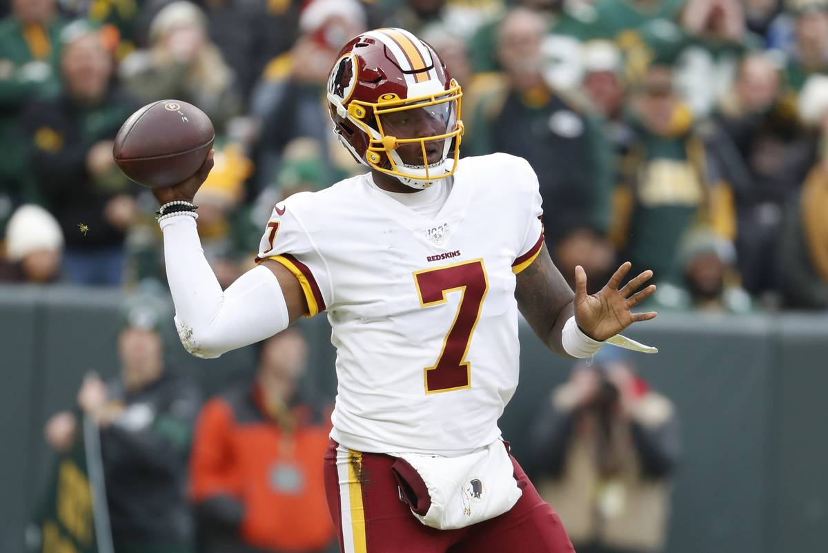 Washington Redskins' Dwayne Haskins throws during the first half of an NFL football game agains ...