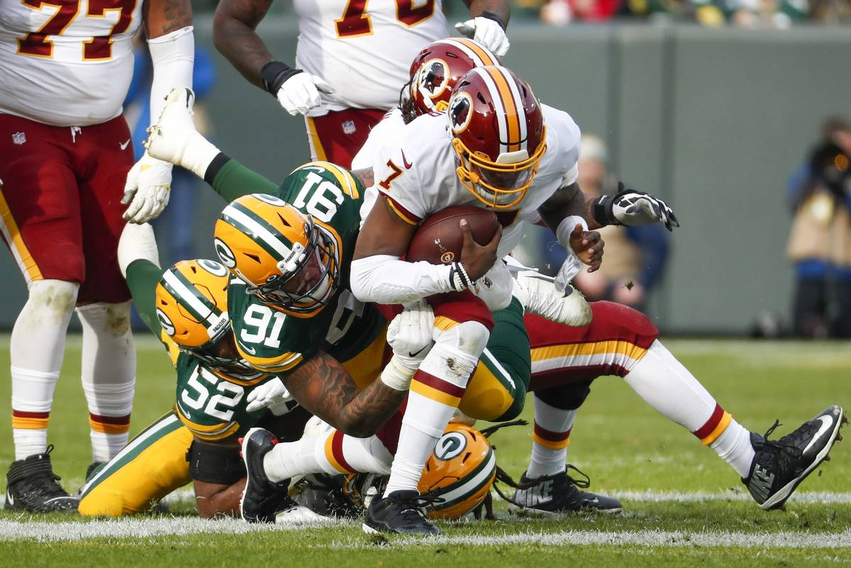 Green Bay Packers' Preston Smith sacks Washington Redskins quarterback Dwayne Haskins during th ...