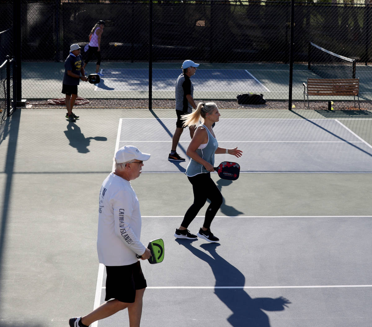 Bob Preusser, left, and Jen Buell, both of Henderson, play pickleball early morning to beat the ...