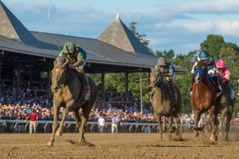 In this Aug. 24, 2019, file photo, Code of Honor, left, with jockey John Velazquez, leads the f ...