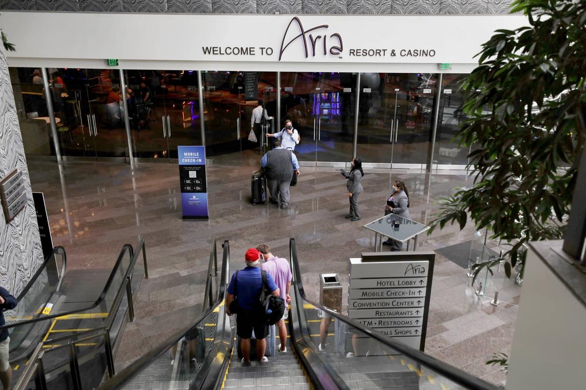 Guests enter Aria on the Las Vegas Strip, Thursday, Aug. 6, 2020, in Las Vegas. (Elizabeth Brum ...