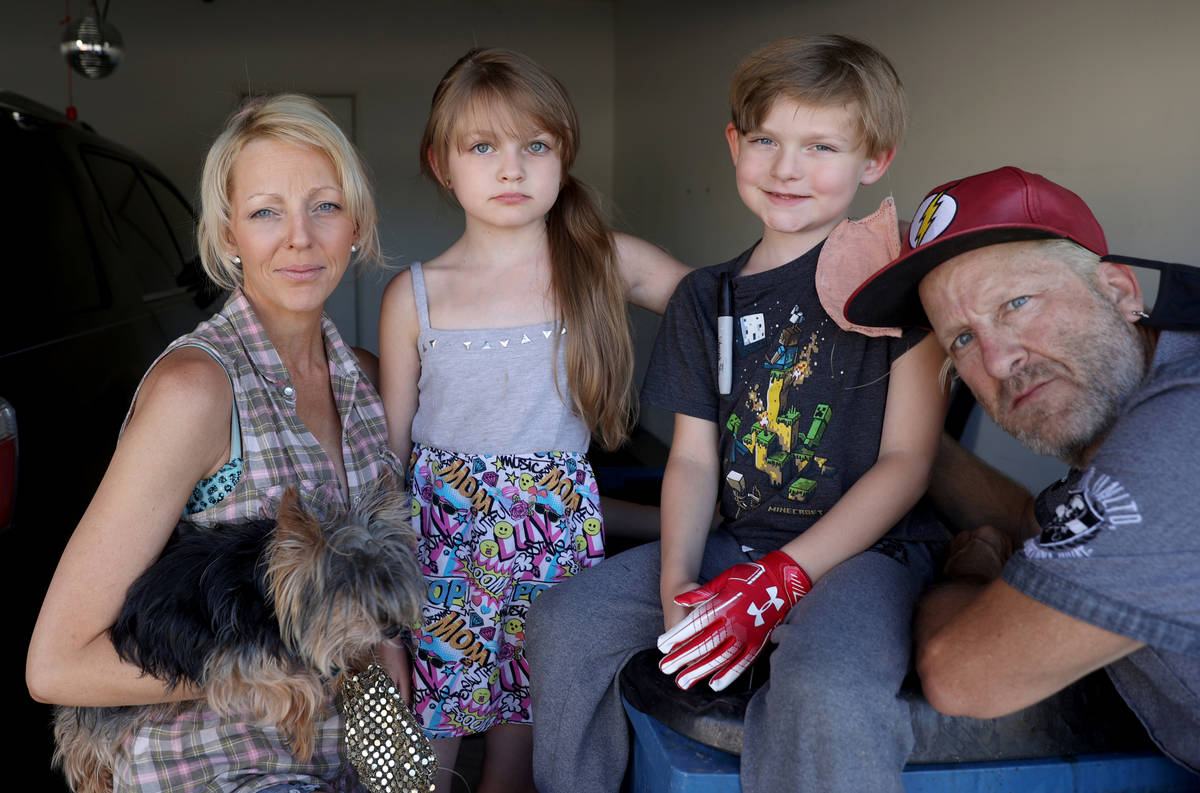 Entertainers Joe and Jessica Trammel with two of their children, Jett, 6, and June River, 10, a ...
