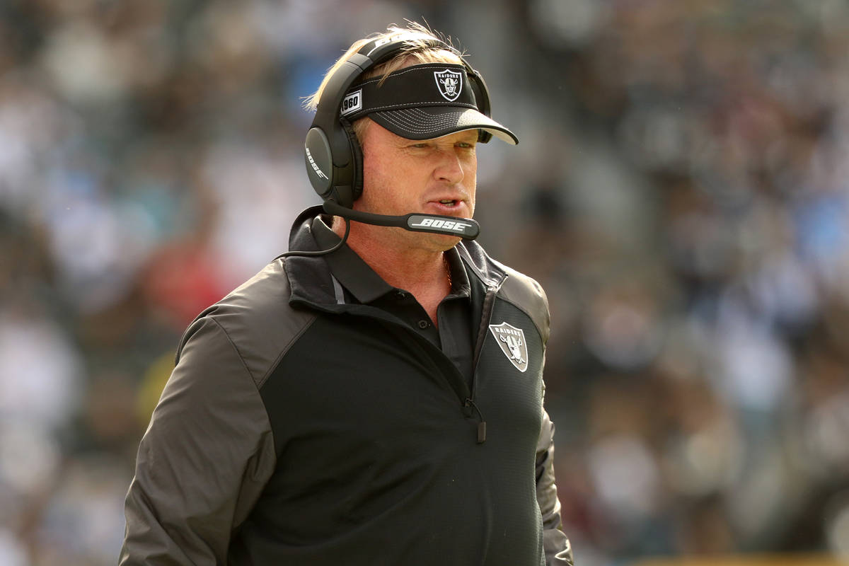 Oakland Raiders head coach Jon Gruden walks the sideline during the first half of an NFL game a ...