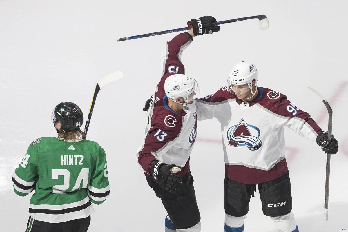 Dallas Stars' Roope Hintz (24) skates past as Colorado Avalanche's Valeri Nichushkin (13) and A ...