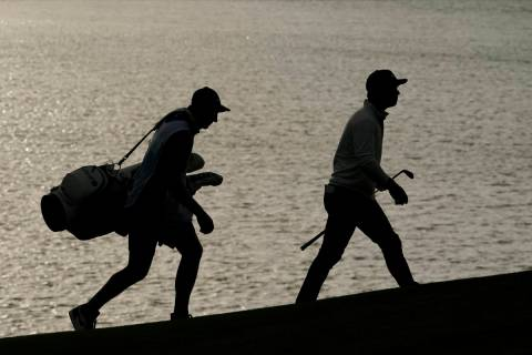 Paul Casey and his caddie walks to the 18th green during the first round of the PGA Championshi ...