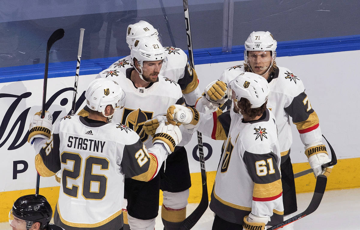 Vegas Golden Knights celebrate a goal during the second period of an NHL hockey playoff game ag ...