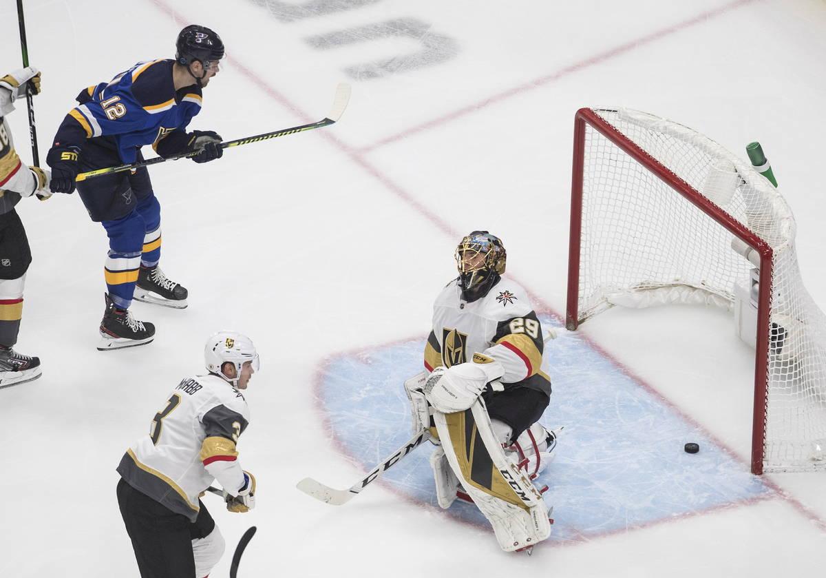 St. Louis Blues' Zach Sanford (12) watches the puck go past Vegas Golden Knights goalie Marc-An ...