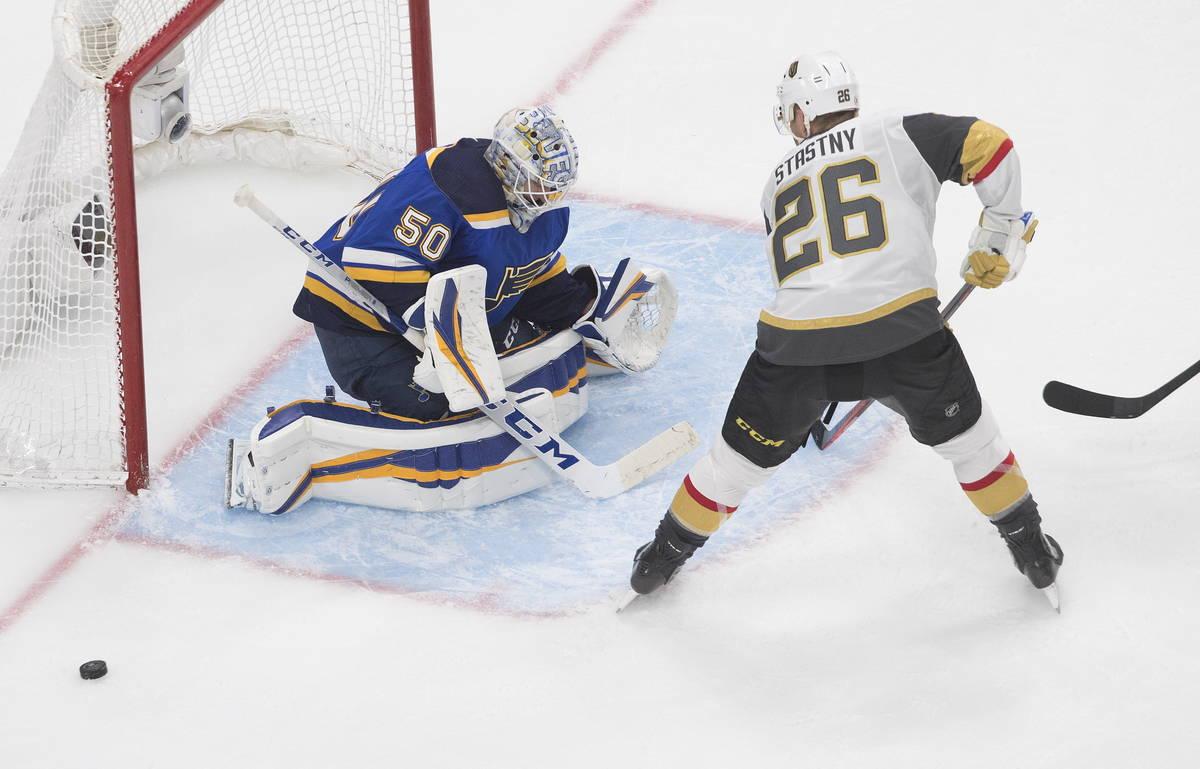 St. Louis Blues goalie Jordan Binnington (50) makes the save on Vegas Golden Knights' Paul Stas ...