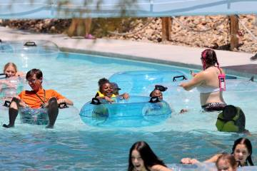 People ride the Lazy River on opening day at Wet 'n' Wild water park in Las Vegas Monday, June ...