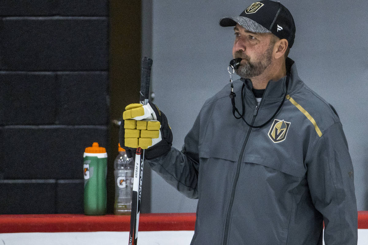 Vegas Golden Knights head coach Peter DeBoer blows his whistle for players during practice at t ...