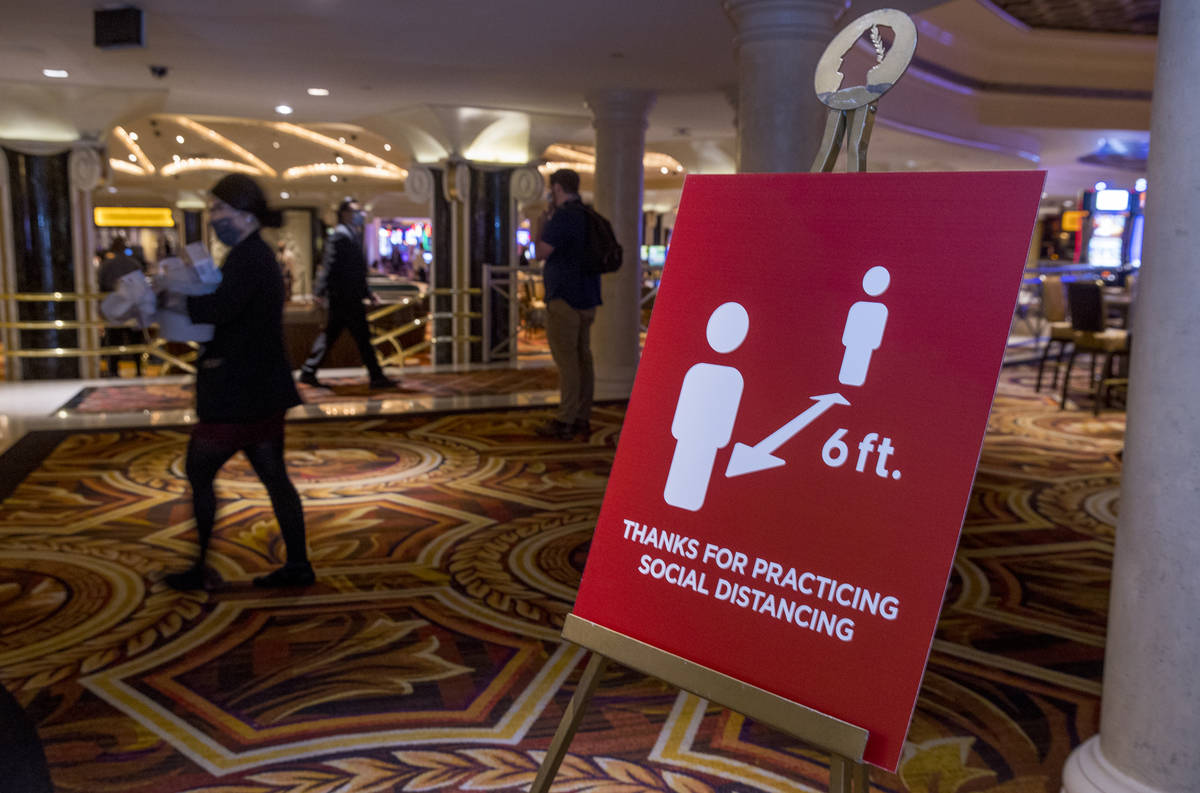 Social distancing signs are all about the lobby area for the re-opening procedures at Caesars P ...