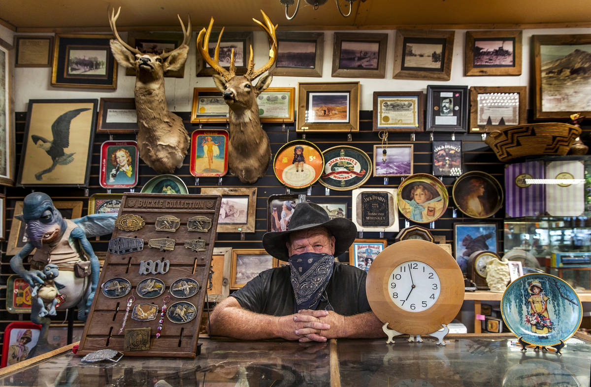Owner Bryan Smalley behind a counter of the Hidden Treasure Trading Co. just into Goldfield alo ...