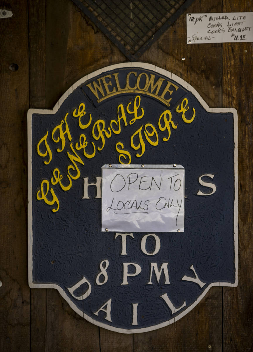 """A sign on the door of The General Store notes they are """"Open to locals only"""" in Goldf ..."""