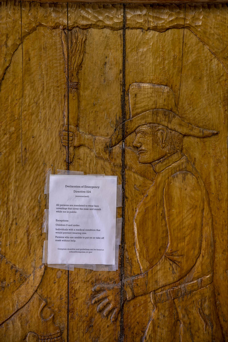 A carved wooden door by owner Bryan Smalley of the Hidden Treasure Trading Co. displays a face ...