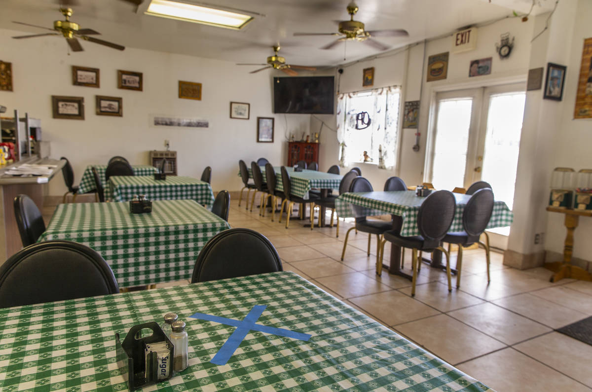 A table in the Dinky Diner is restricted for seating in Goldfield along I-95 and apart of Esmer ...