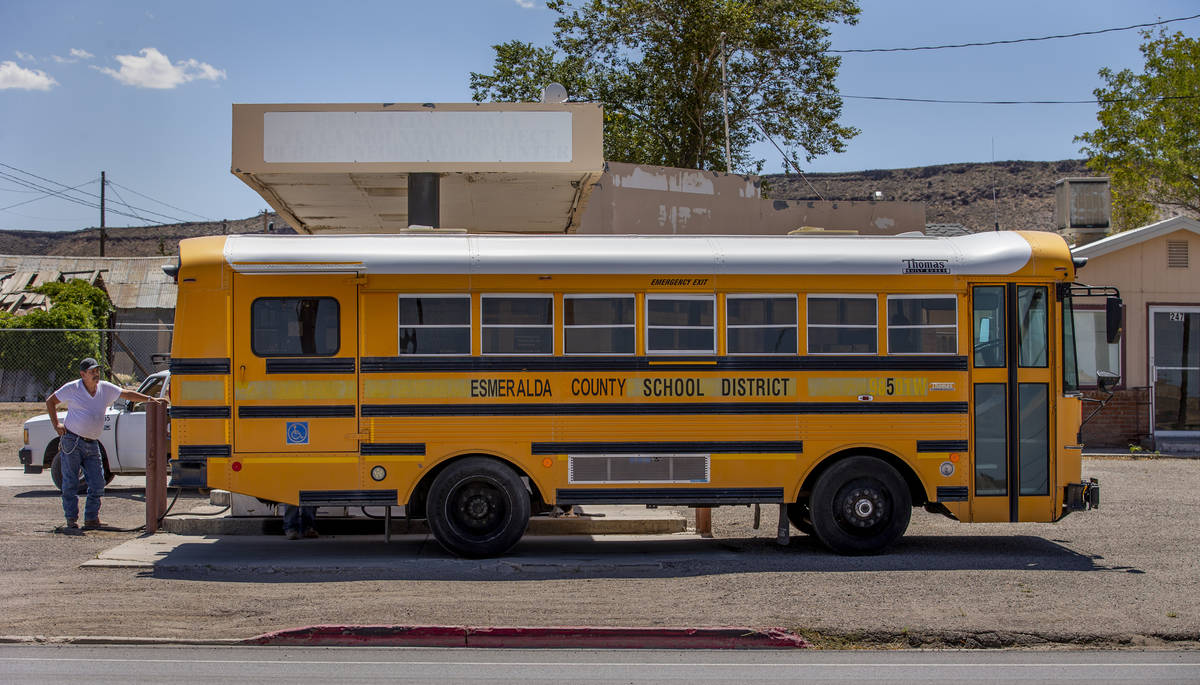 An Esmeralda County School District bus is refueled in Goldfield along I-95 on Tuesday, August ...