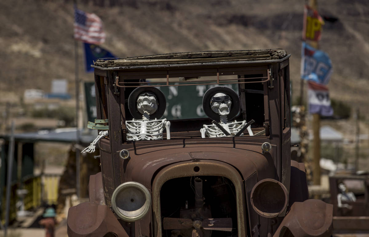 Skeletons are apart of a play on ÒMen in BlackÓ on display in front of the Hidden Tre ...