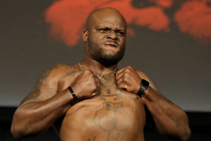 Derrick Lewis reacts while posing atop a scale prior to his heavyweight mixed martial arts bout ...