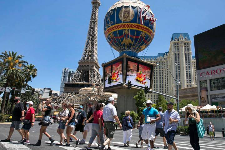 Tourists cross Las Vegas Boulevard near Paris Las Vegas, July 3, 2020. (Bizuayehu Tesfaye/Las V ...