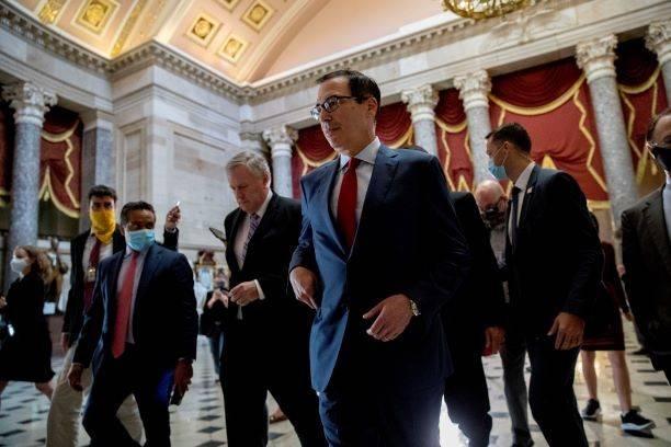 White House Chief of Staff Mark Meadows, center left, and Treasury Secretary Steven Mnuchin, ce ...