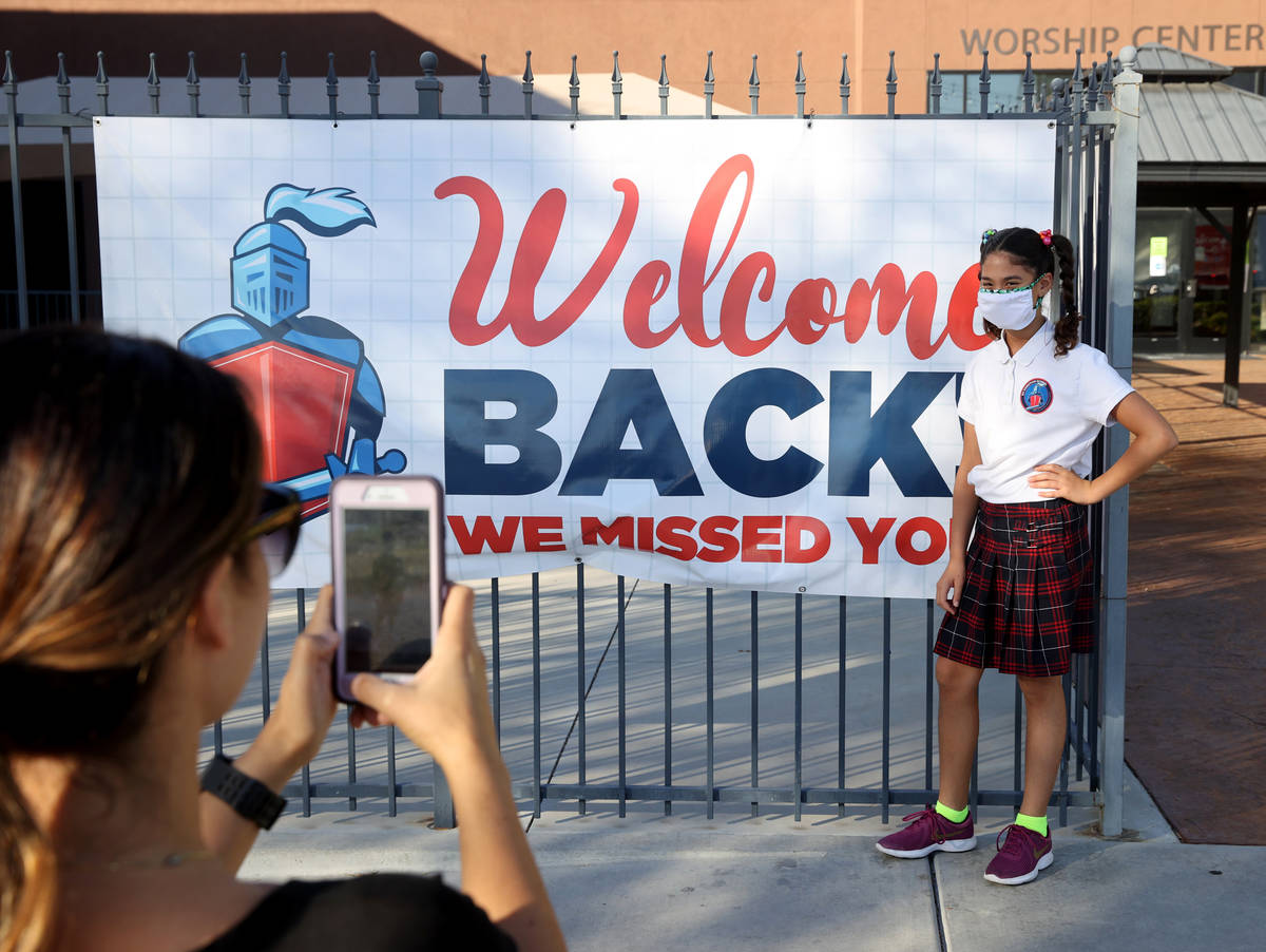 Zarah Ghadban gets her photo taken by her mother Mariam on the first day of school at Green Val ...