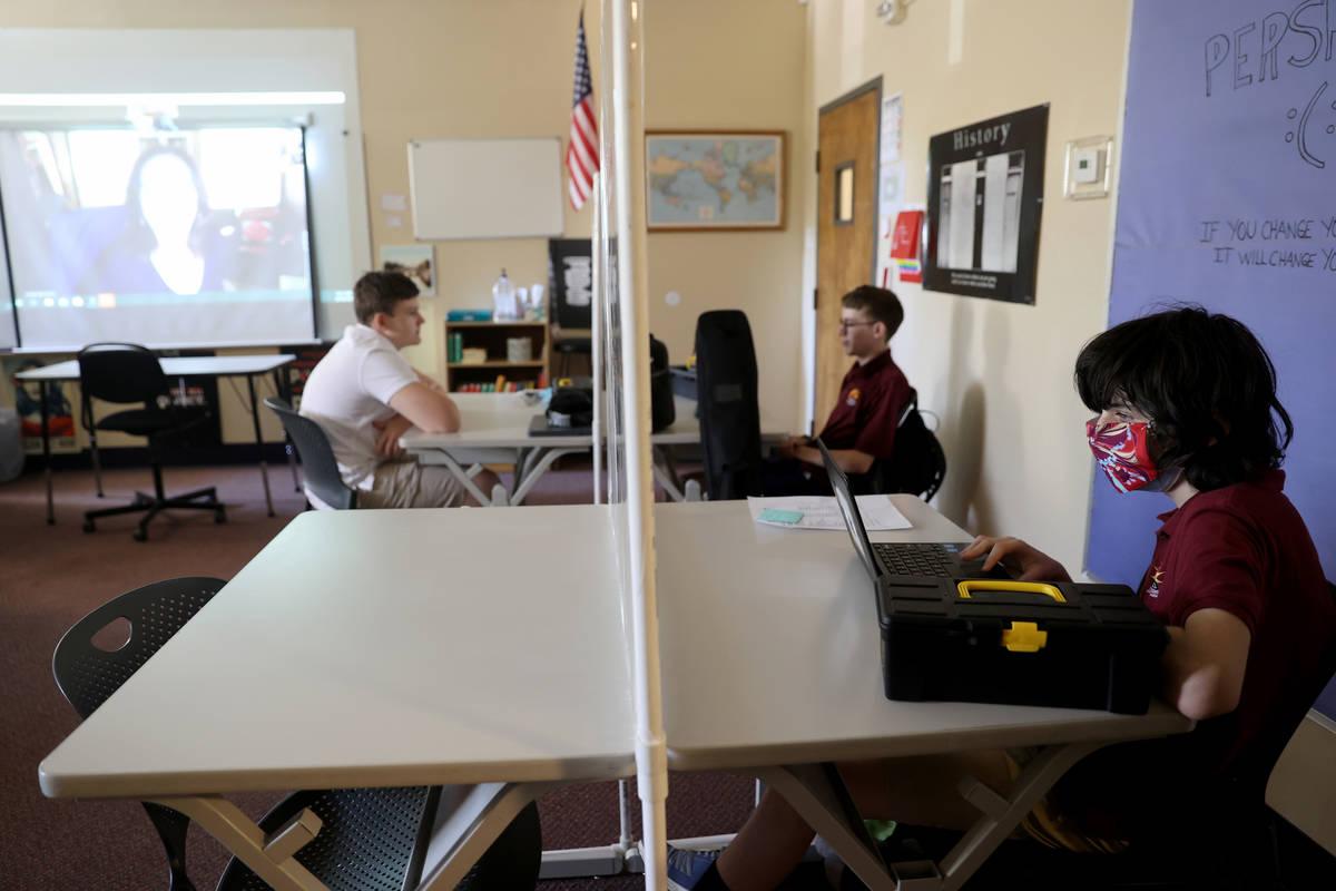 Tenth grader Jacob Braunstein listens to English literaturer teacher Sandy McCluney the first d ...