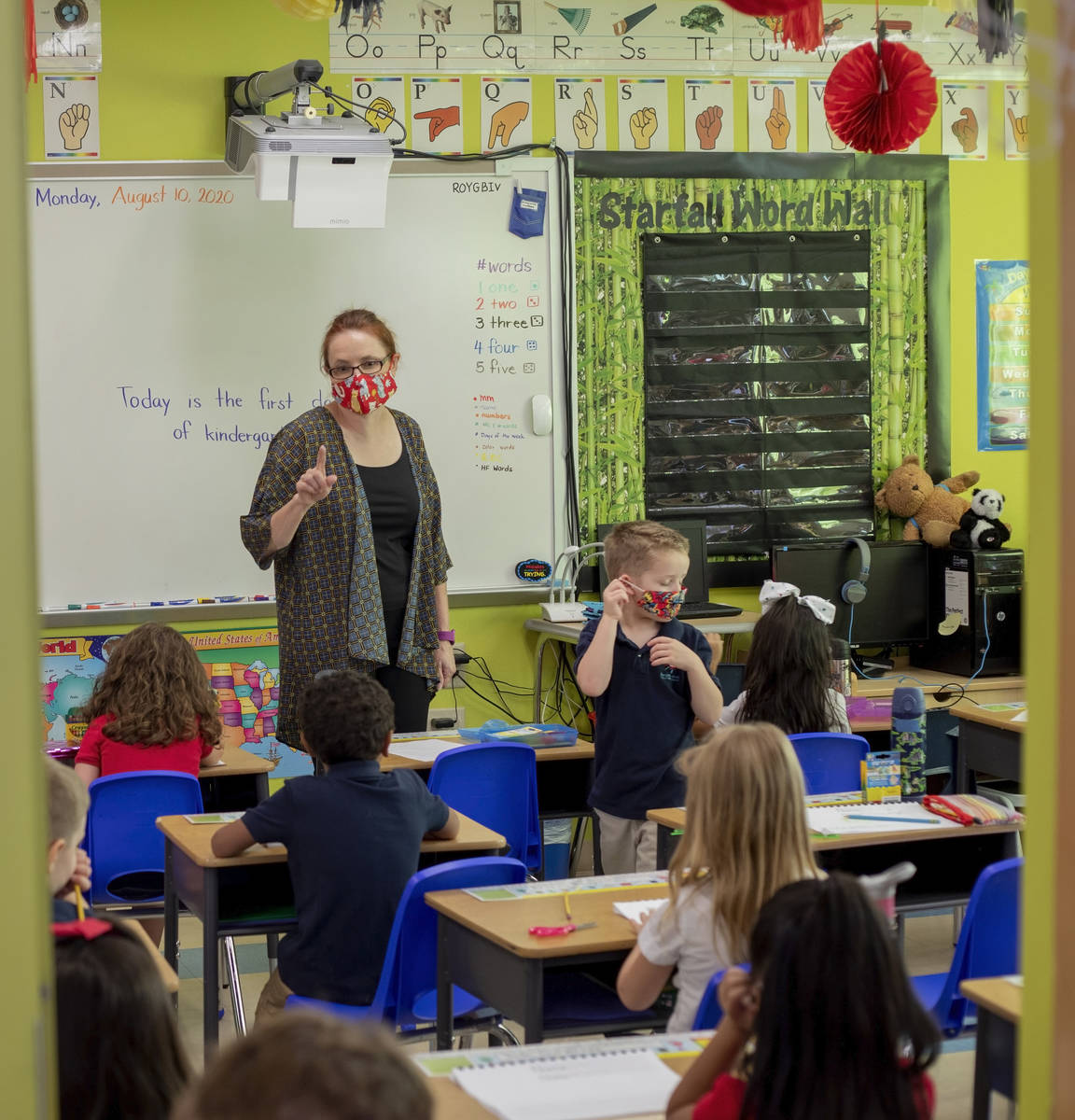 Kindergarten lead Sheryl Davis-Haas instructs students during the first day of school at Shenke ...