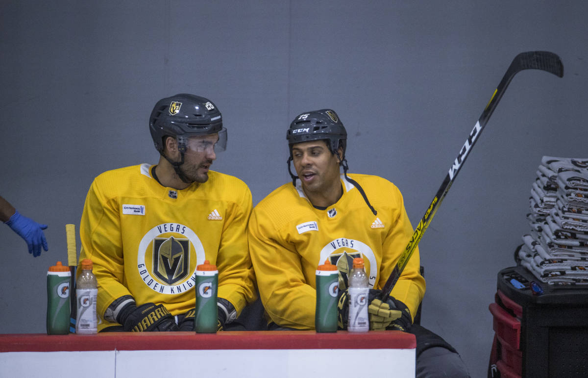 Vegas Golden Knights left wing William Carrier (28, left) and right wing Ryan Reaves (75) talk ...
