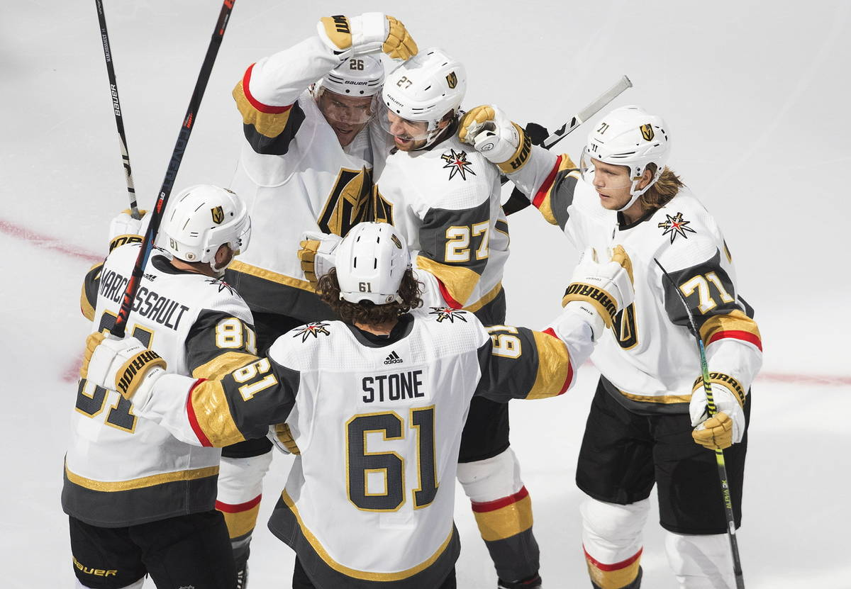 Vegas Golden Knights celebrate a goal during the second period of an NHL Stanley Cup qualifying ...