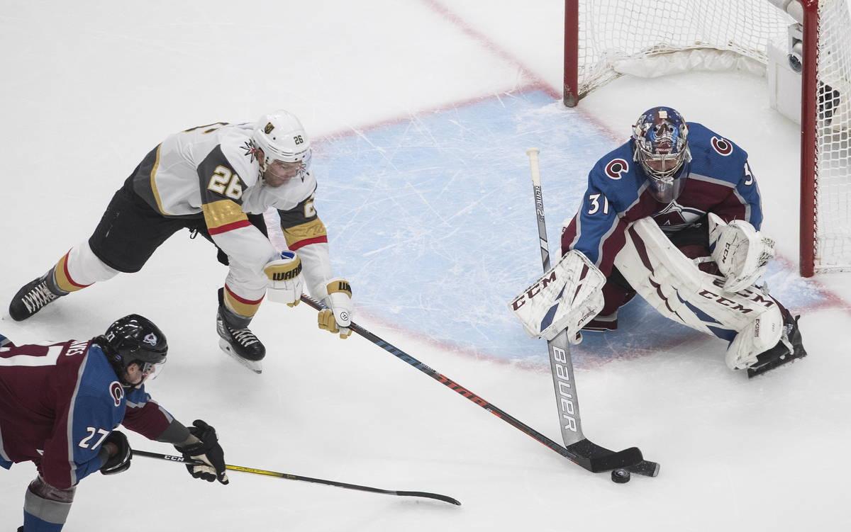 Colorado Avalanche goalie Philipp Grubauer (31) stops Vegas Golden Knights' Paul Stastny (26) d ...