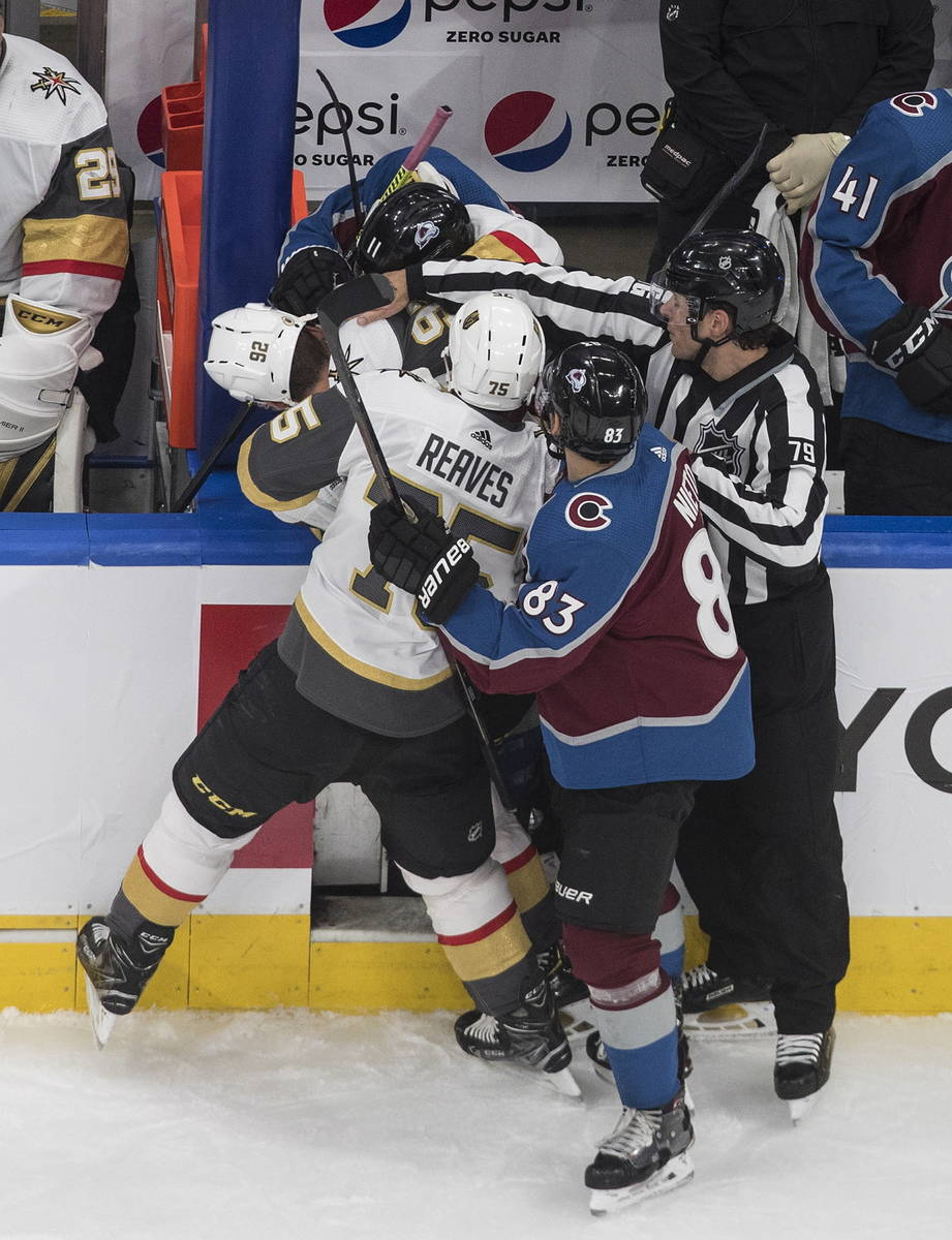 Colorado Avalanche and the Vegas Golden Knights players mix it up during the third period of an ...